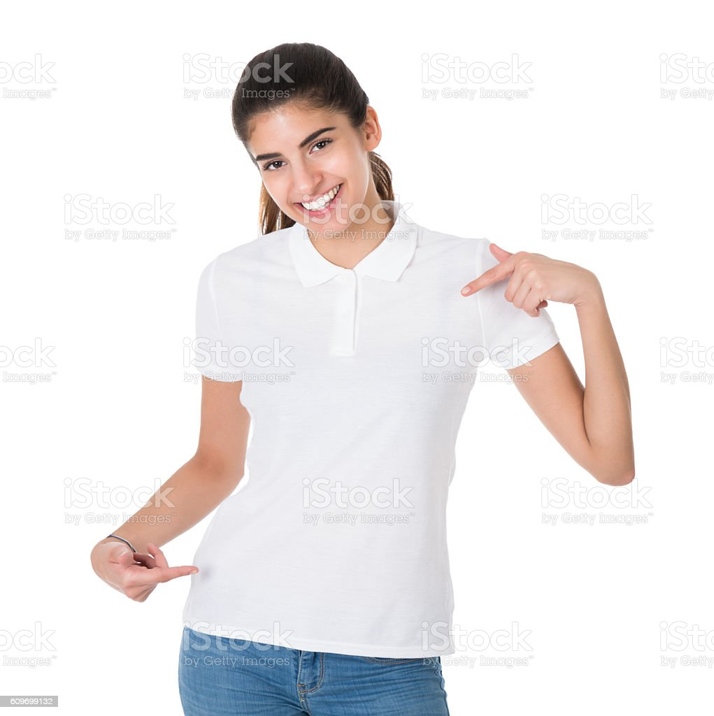 Smiling Young Woman Pointing Towards Blank Tshirt stock photo
