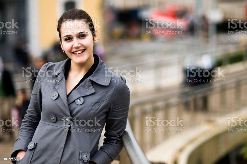Smiling Young Woman Posing on Bridge royalty-free stock photo