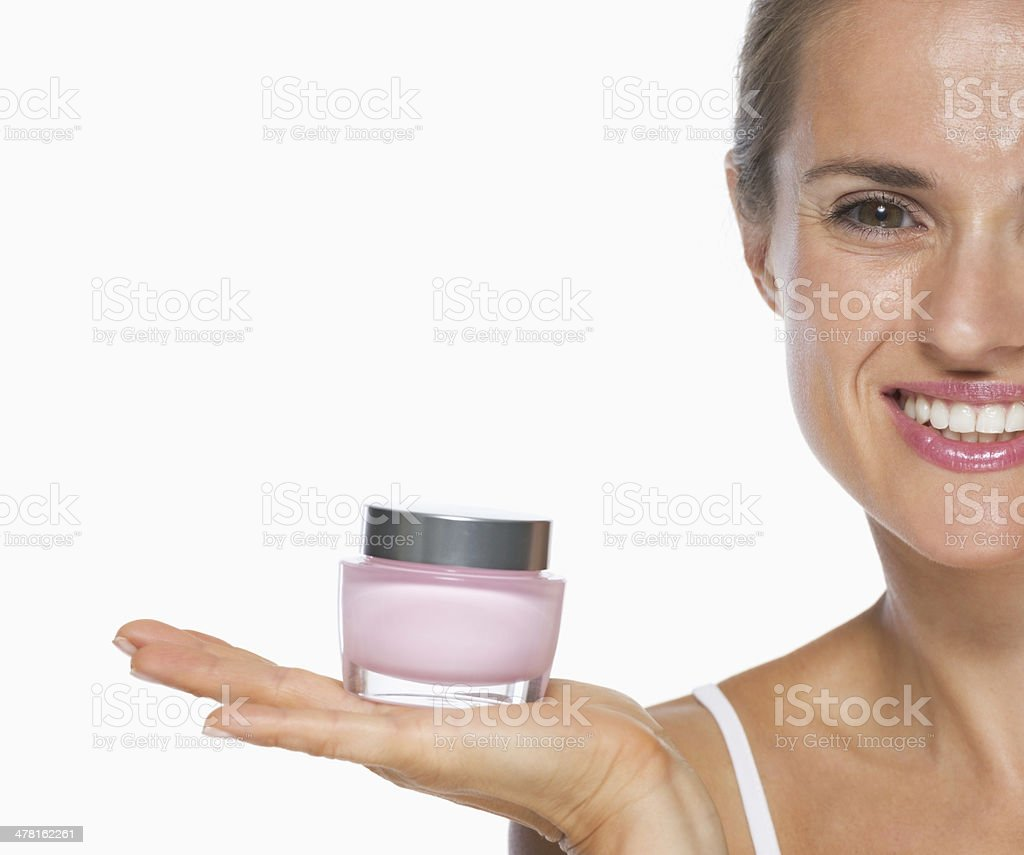 smiling young woman showing creme royalty-free stock photo