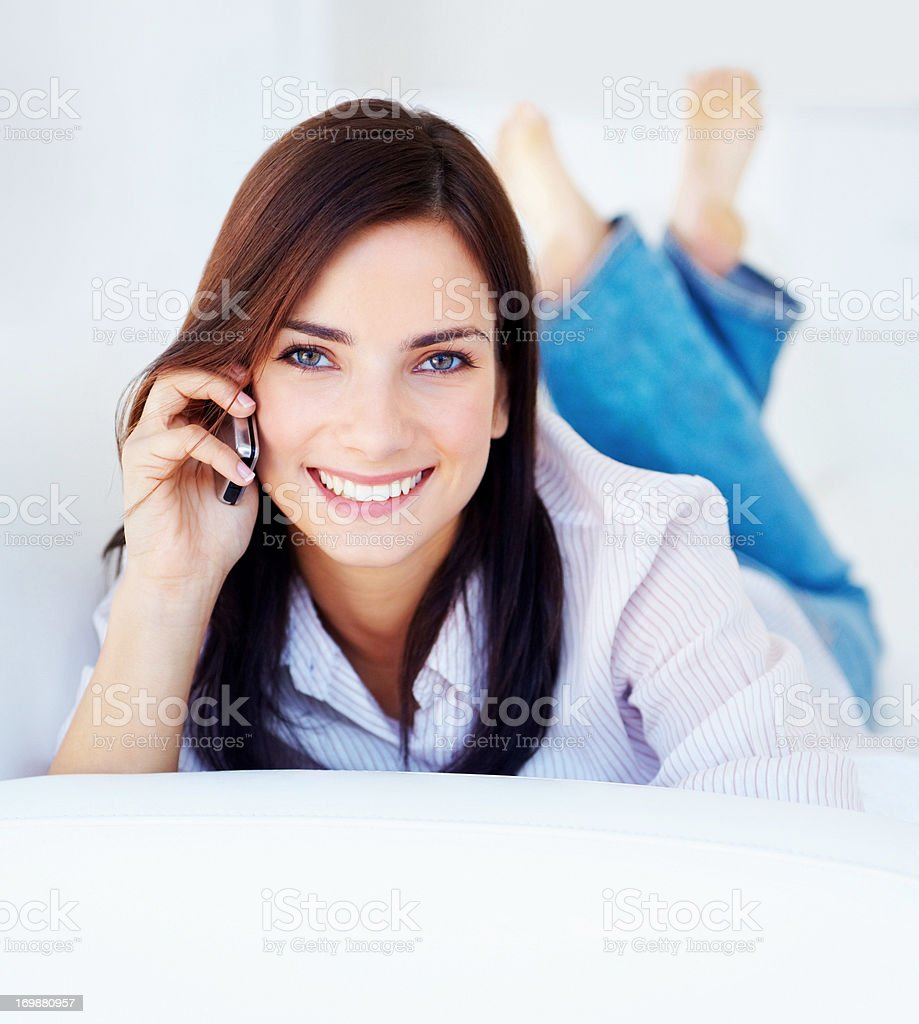 Smiling young woman talking on the phone stock photo