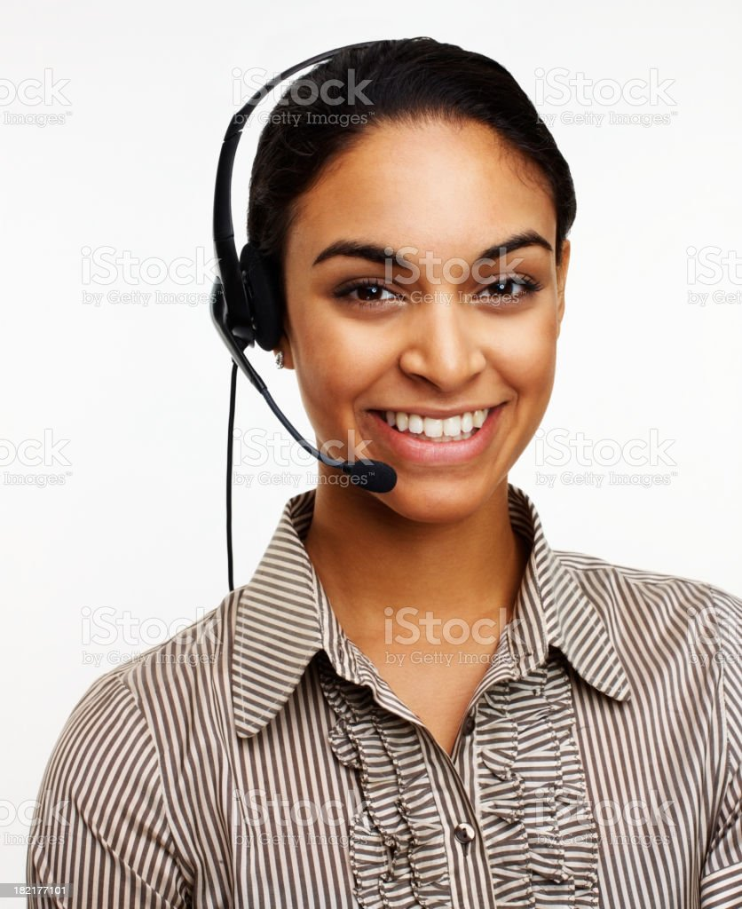Smiling young woman wearing telephone headset royalty-free stock photo