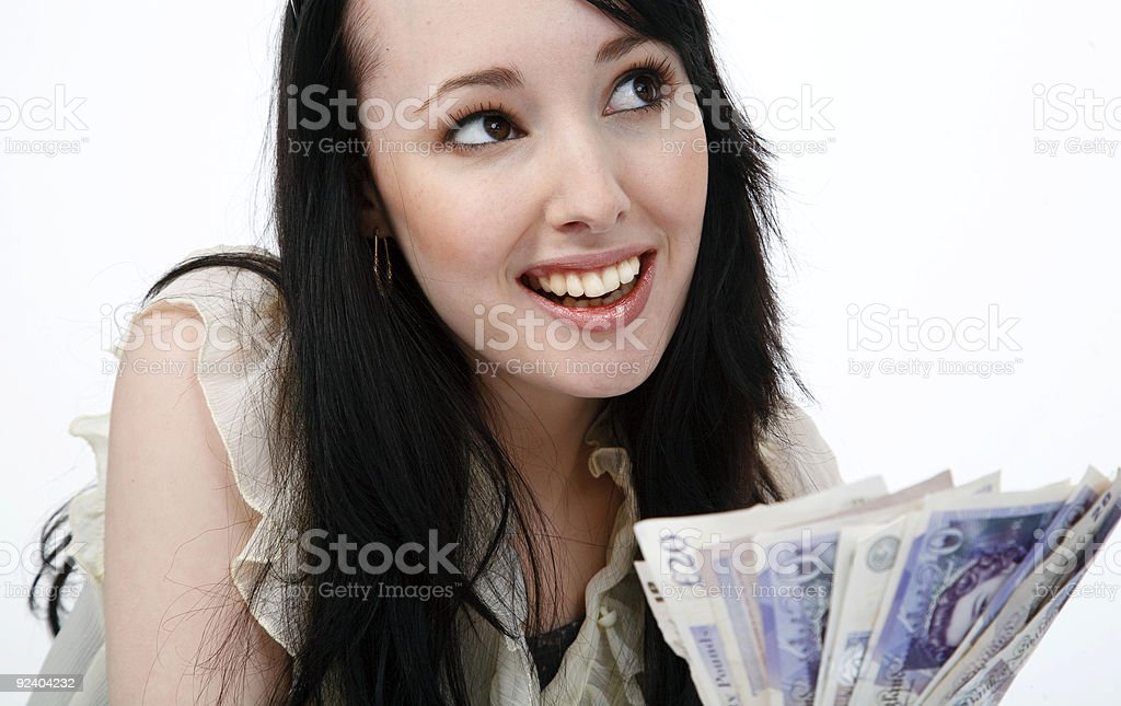 Smiling young woman with a handful of cash royalty-free stock photo