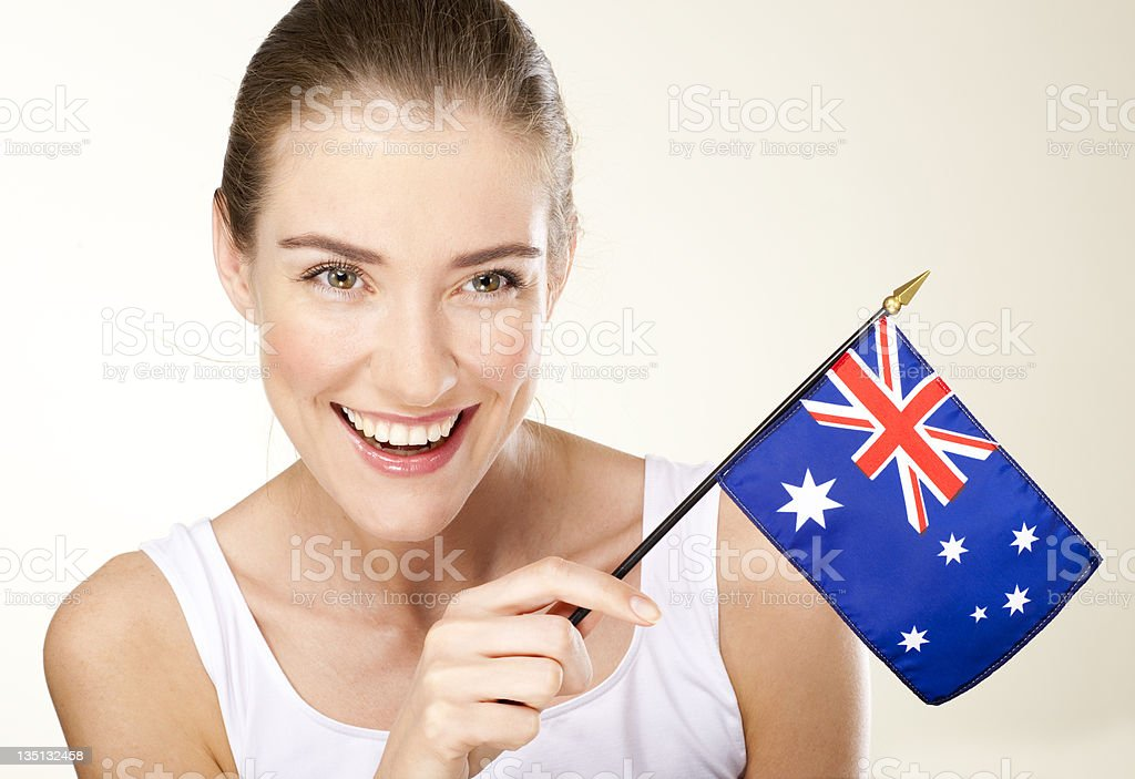smiling young woman with Australian  flag royalty-free stock photo