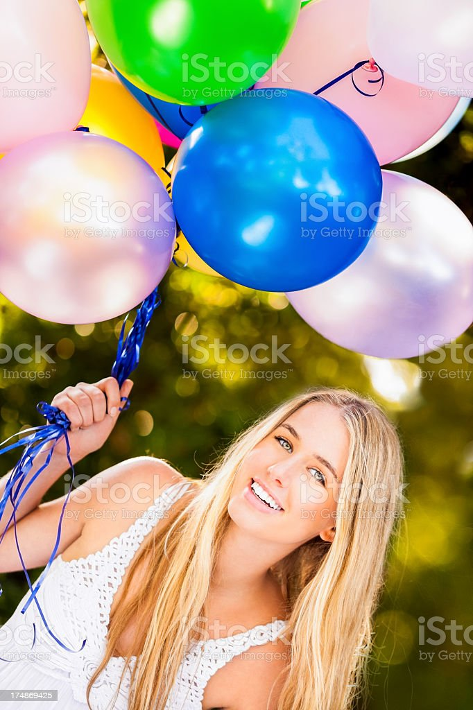 Smiling Young Woman With Balloons royalty-free stock photo