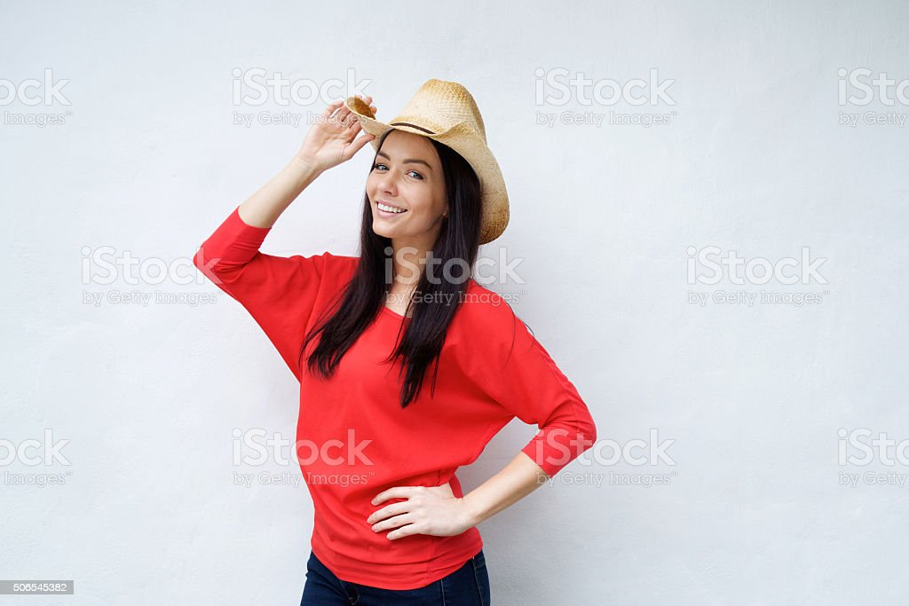 Smiling young woman with cowboy hat stock photo