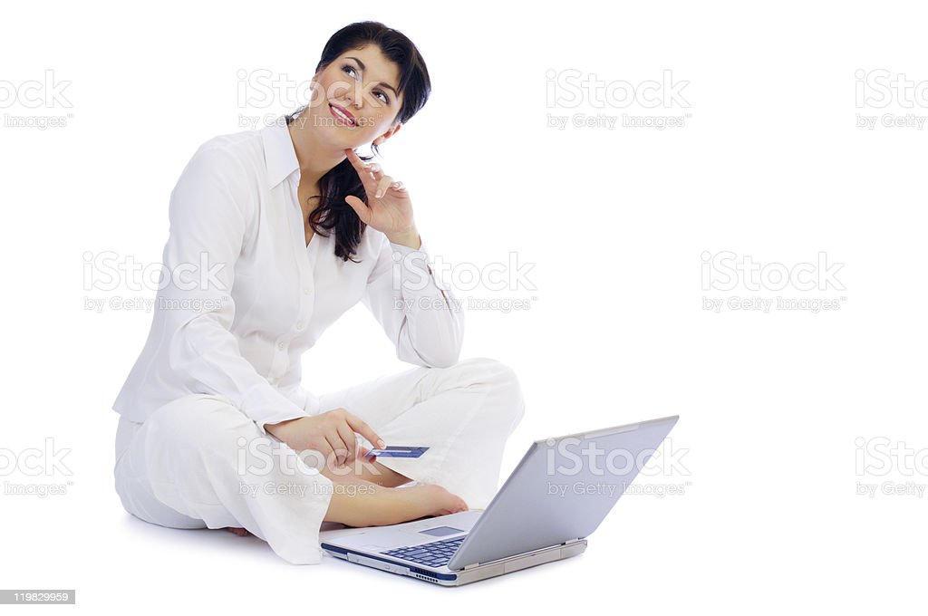 Smiling young woman with credit card and laptop royalty-free stock photo