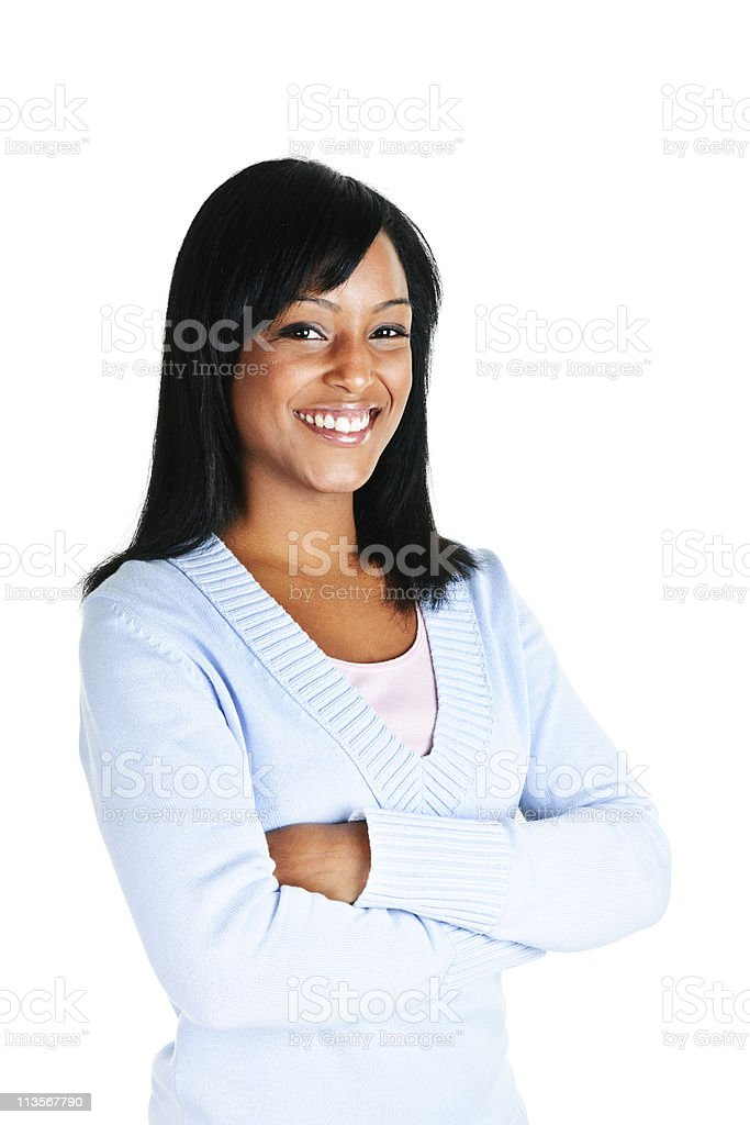 Smiling young woman with crossed arms stock photo
