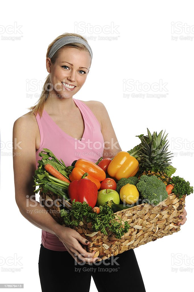 Smiling Young Woman with Fruits and Vegetables royalty-free stock photo