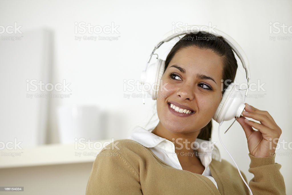 Smiling young woman with headphone listening music royalty-free stock photo