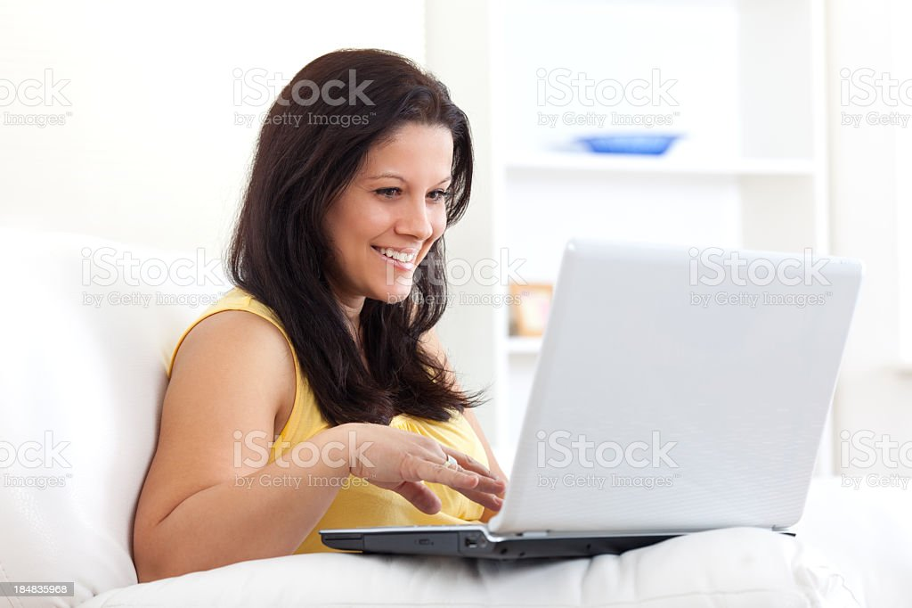 Smiling young woman with laptop royalty-free stock photo
