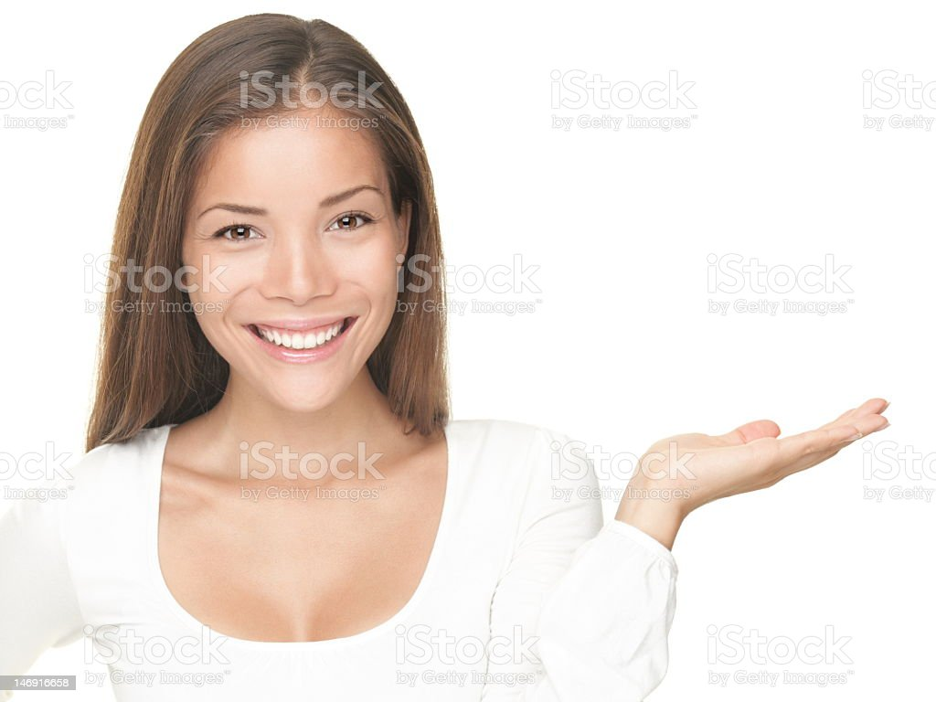 Smiling young woman with open hand to show something royalty-free stock photo