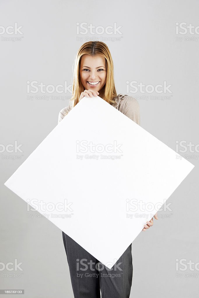 Smiling young woman with sign Whiteboard. royalty-free stock photo