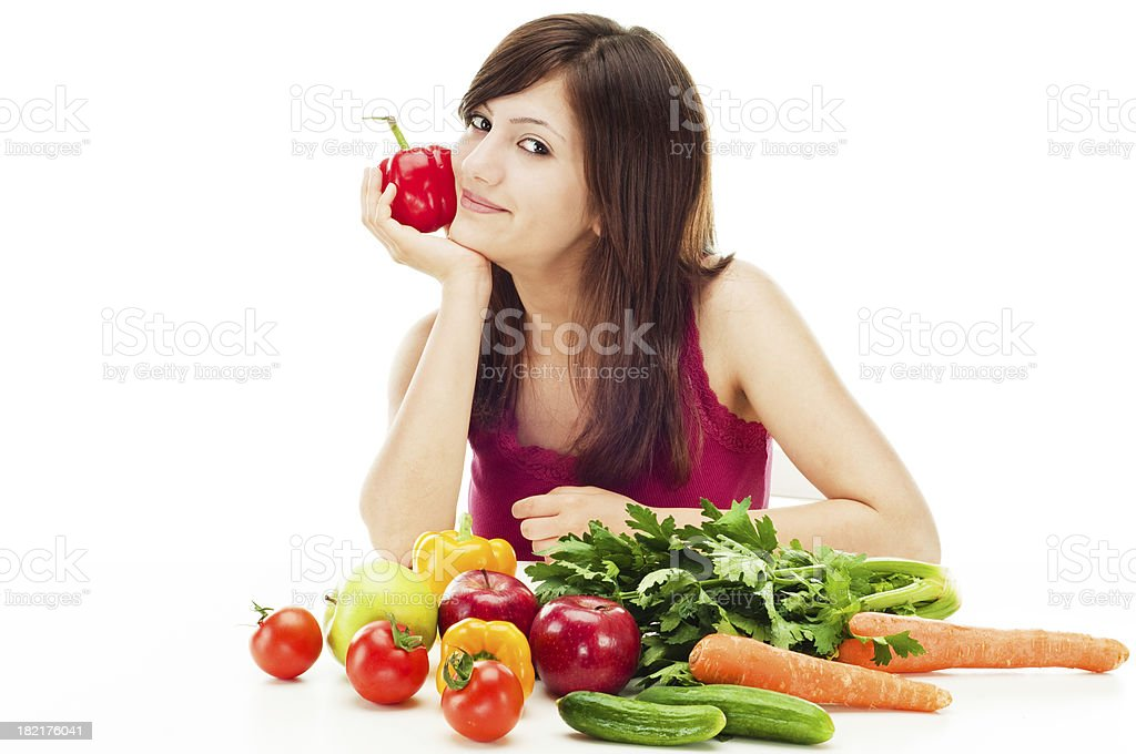 Smiling young woman with vegetables and fruits royalty-free stock photo