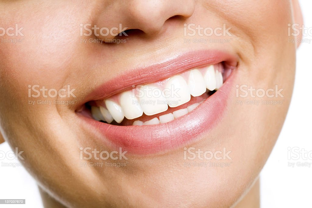 Smiling young woman with white teeth stock photo