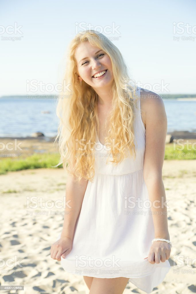 Smiling youthful woman in dress with hairs royalty-free stock photo