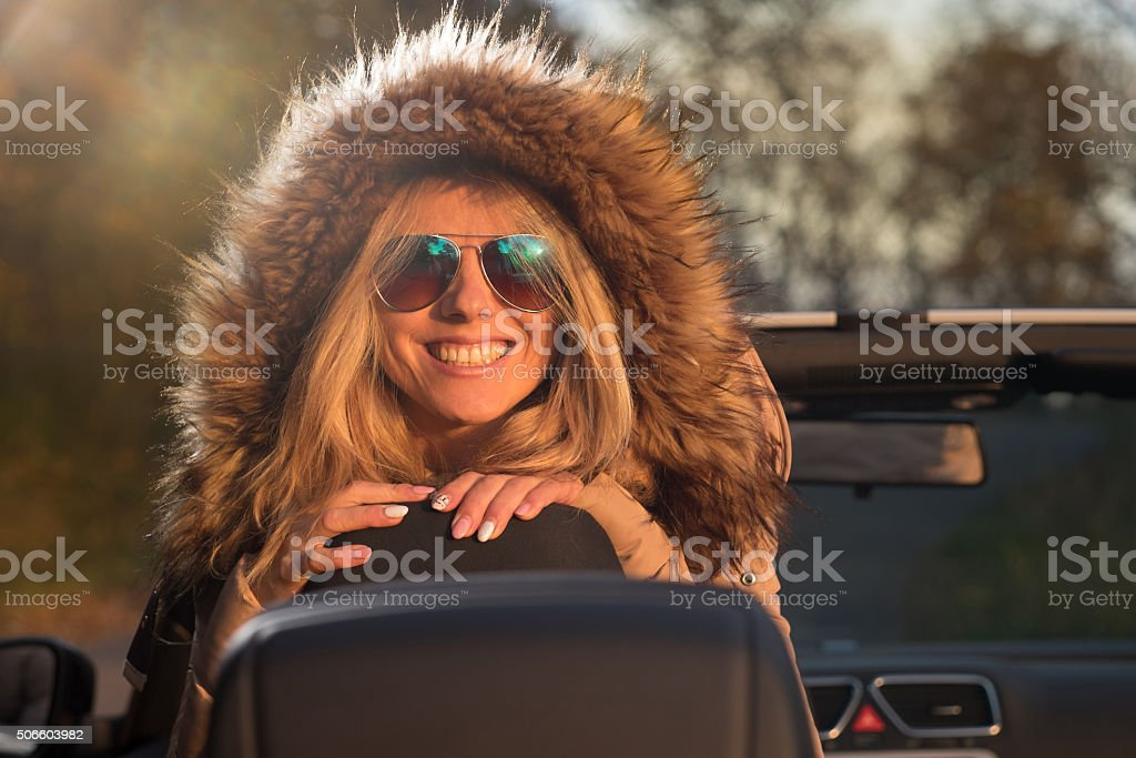 smilling prety girl posing in the cabriolet stock photo