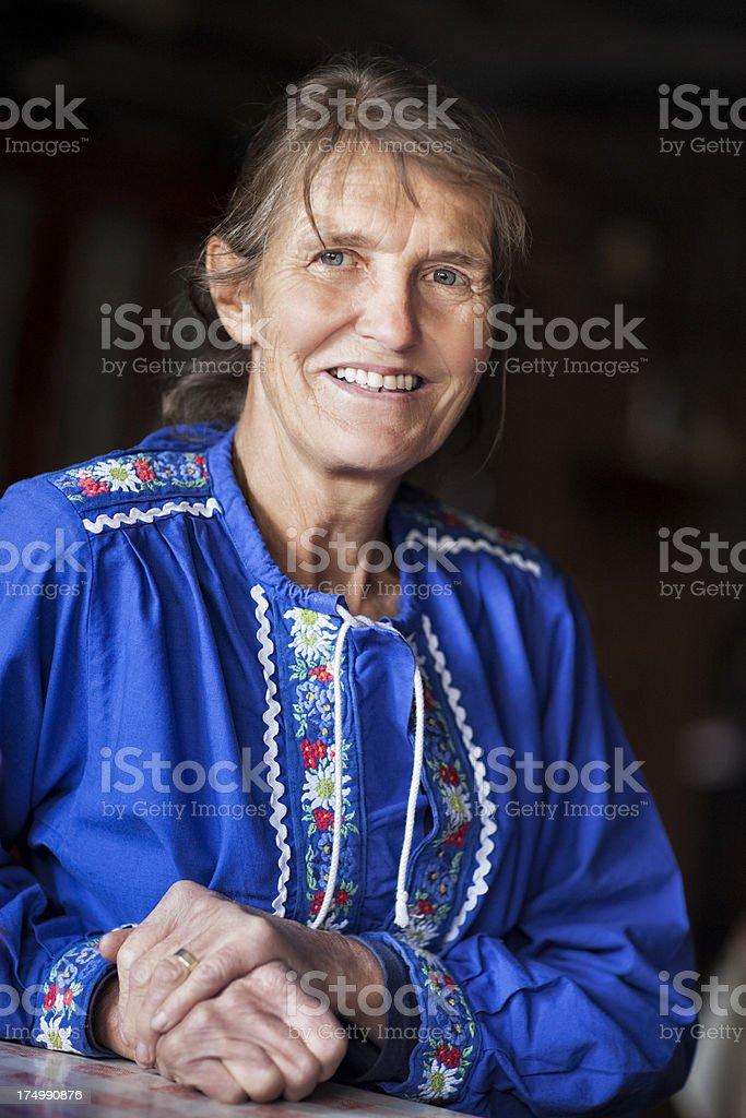 Smilling Swiss Senior Woman Traditionally Dressed. stock photo