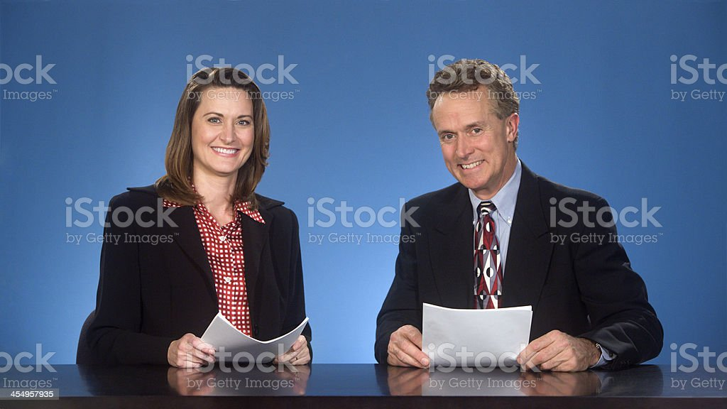 Smilng newcasters. stock photo