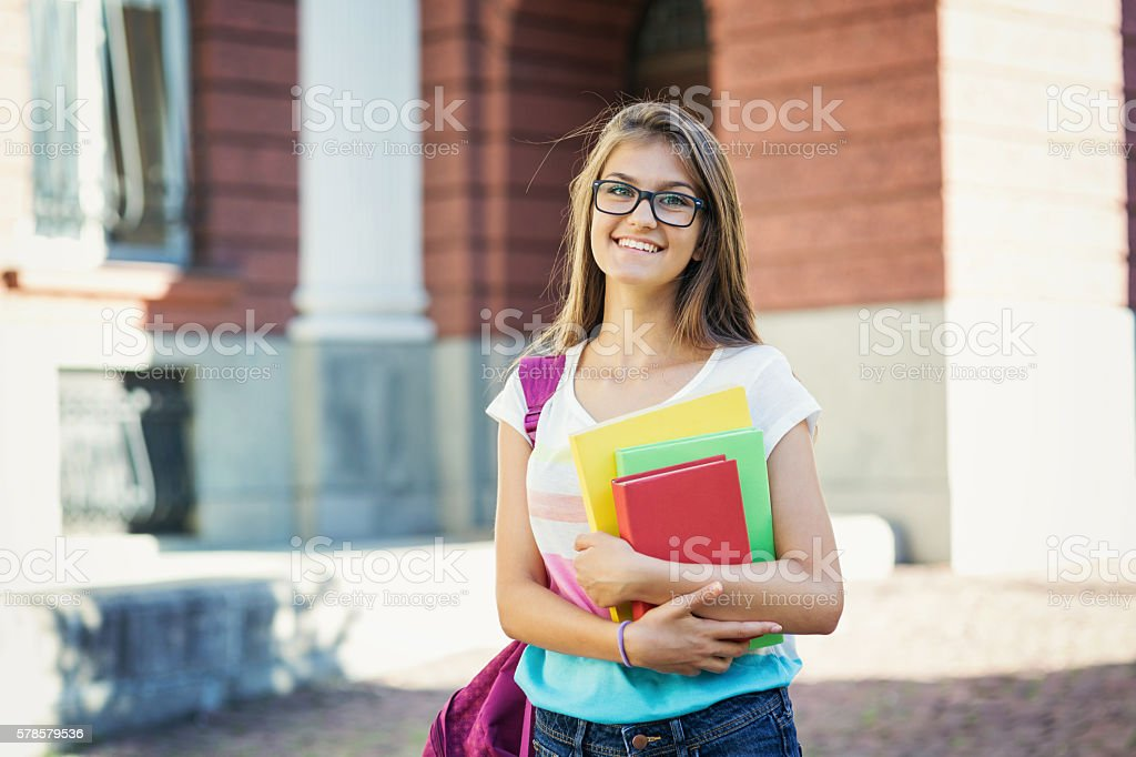 Smily school girl stock photo