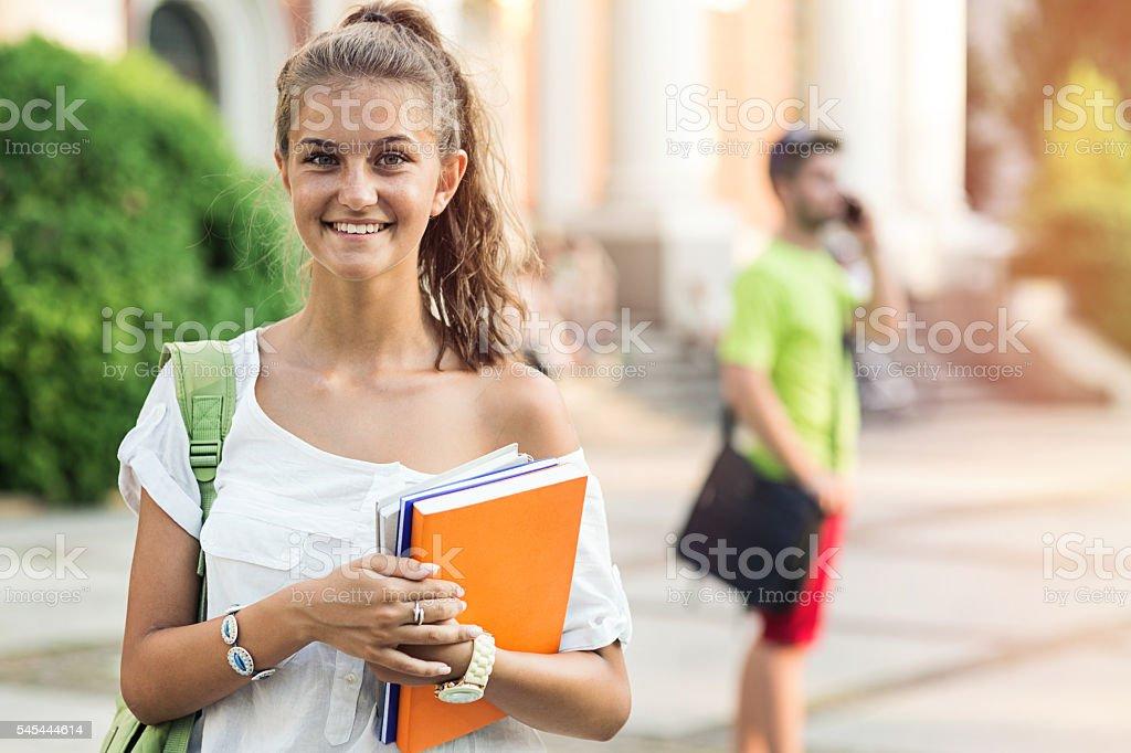 Smily schoolgirl stock photo