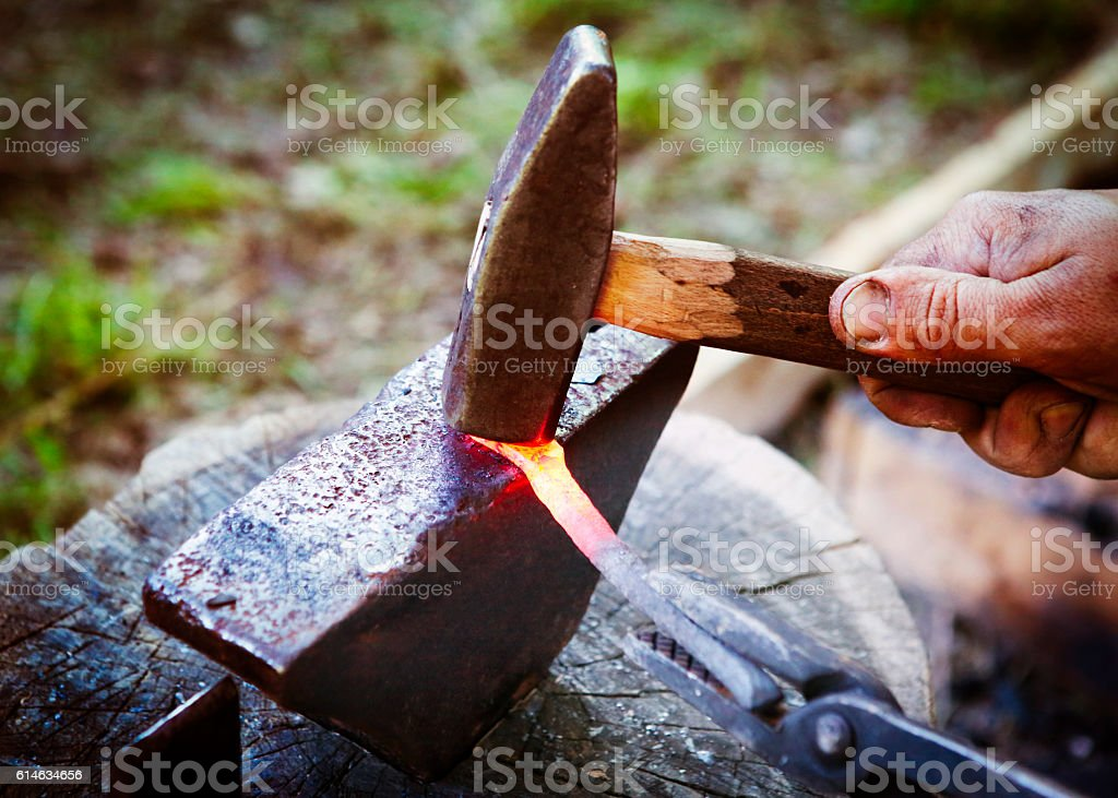 Smith working with hammer stock photo
