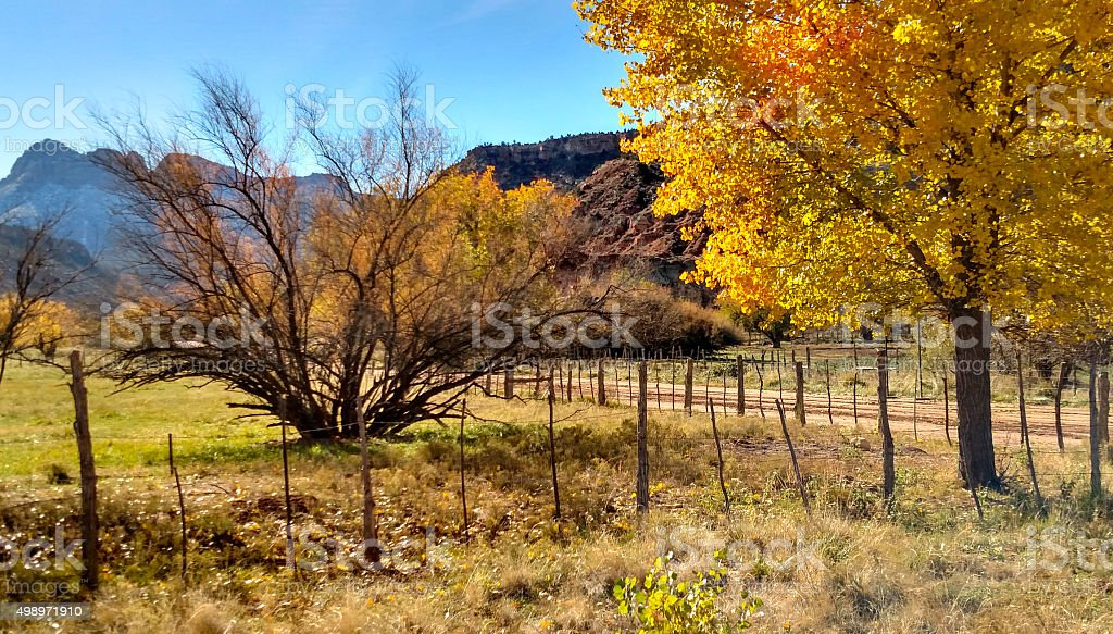 Smithsonian Butte fences country road Grafton Ghost Town Rockville Utah stock photo