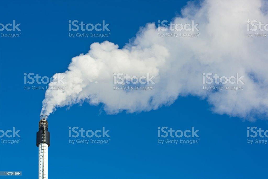 Smoke against blue sky royalty-free stock photo
