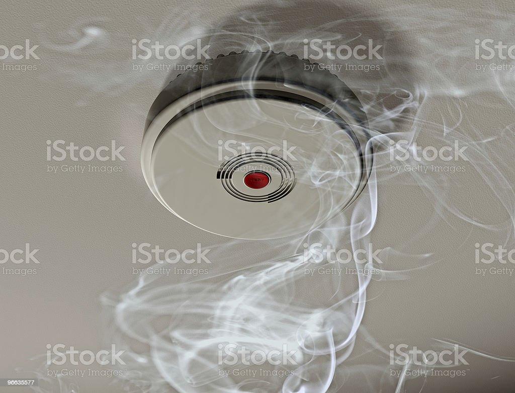 Smoke alarm in a smoky room stock photo