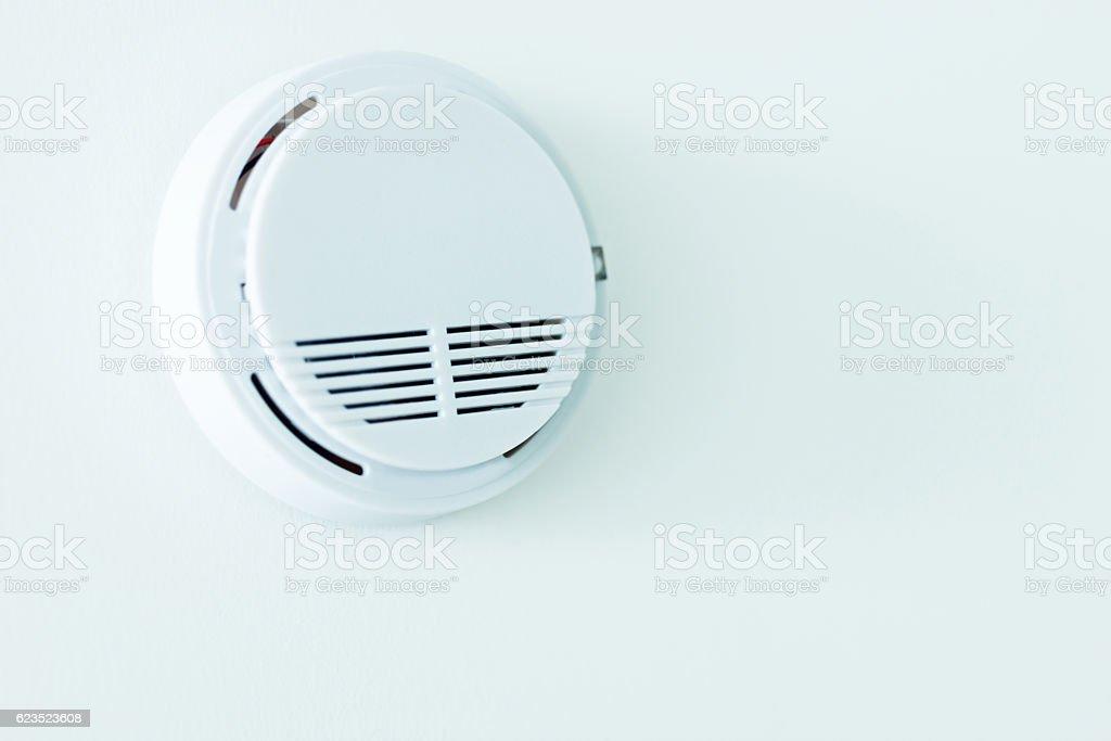 Smoke alarm on the ceiling stock photo