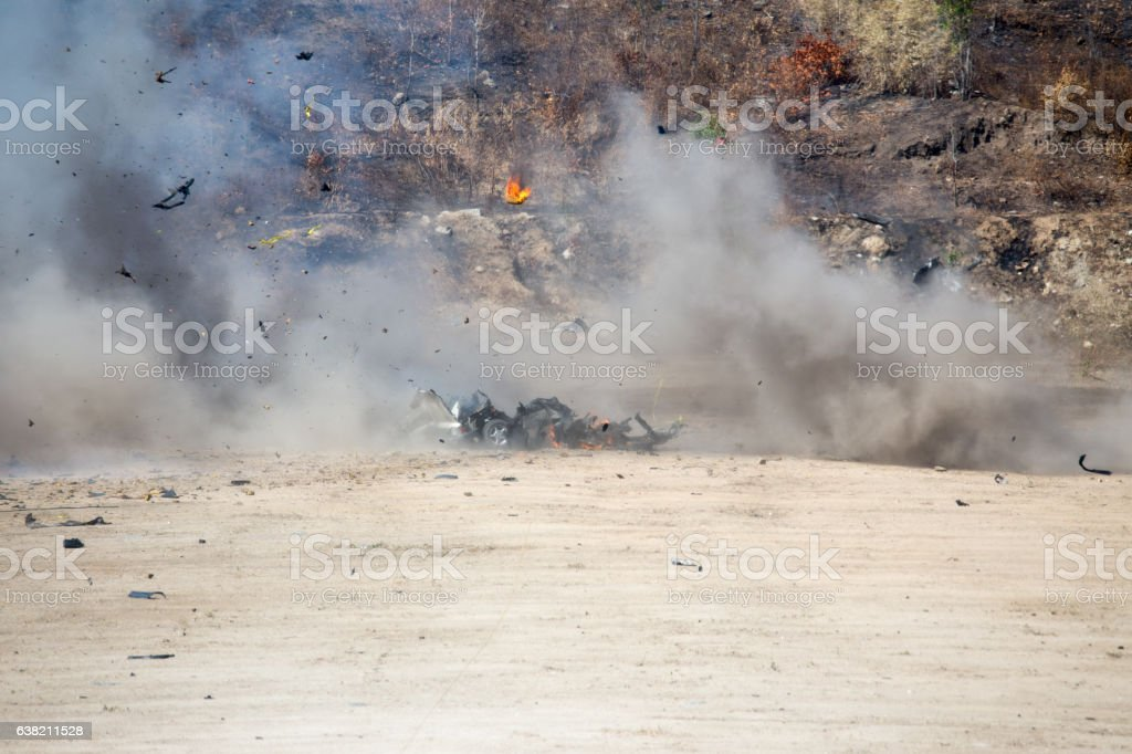smoke and car part blown away from car bomb training stock photo