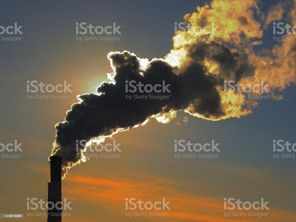 Smoke at sunset 3 stock photo