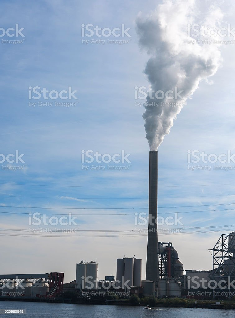 Smoke chimney of a power plant stock photo