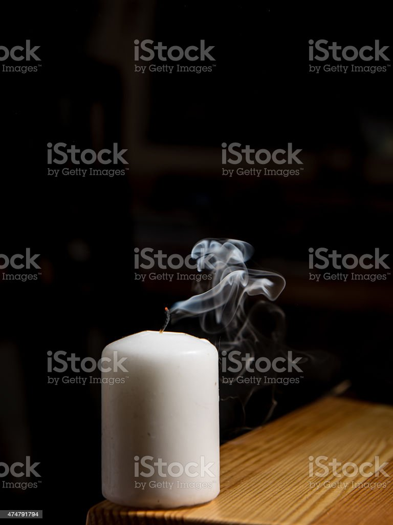 Smoke coming from a blown out candle stock photo