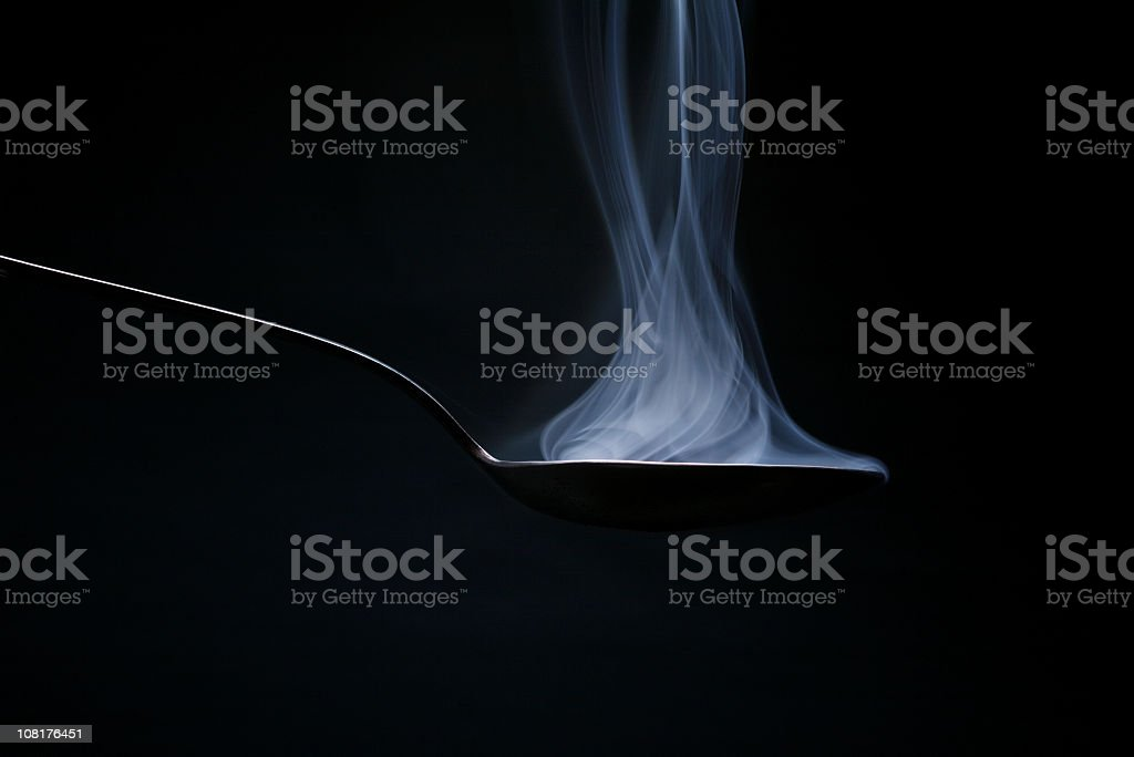Smoke Coming Off Spoon royalty-free stock photo