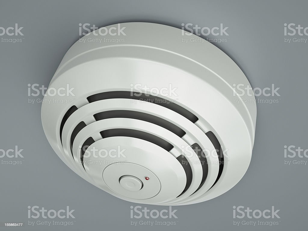 Smoke detector attached to the ceiling stock photo