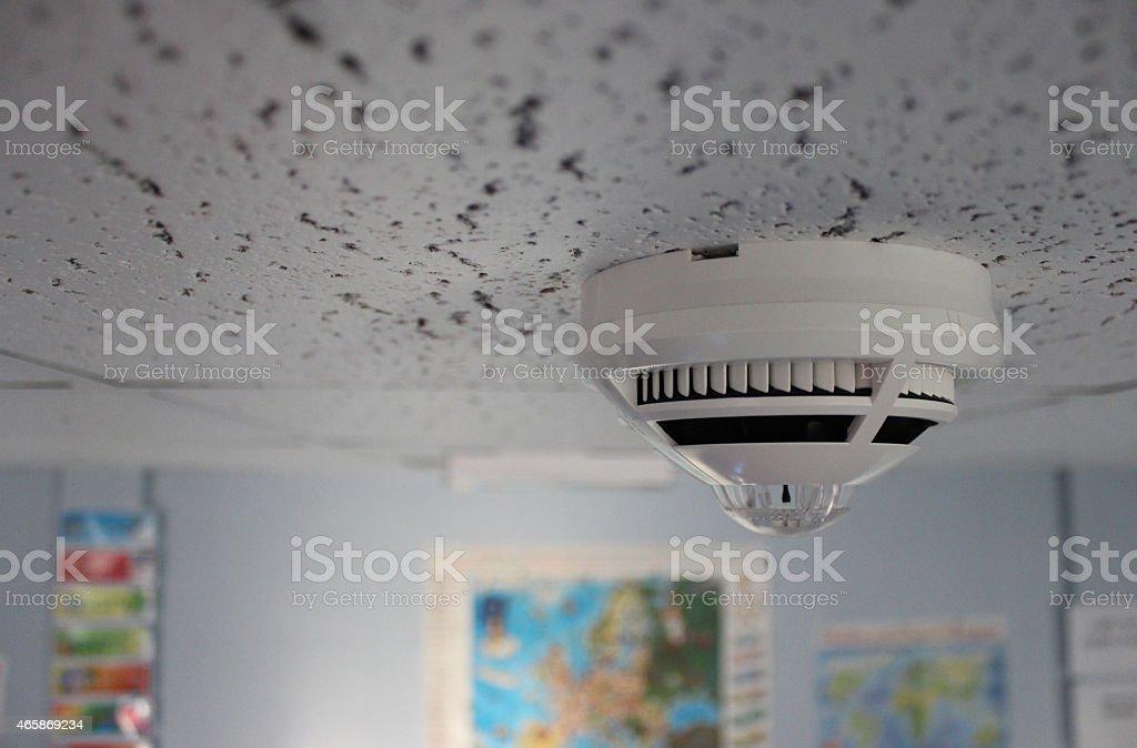 Smoke Detector on School Ceiling stock photo