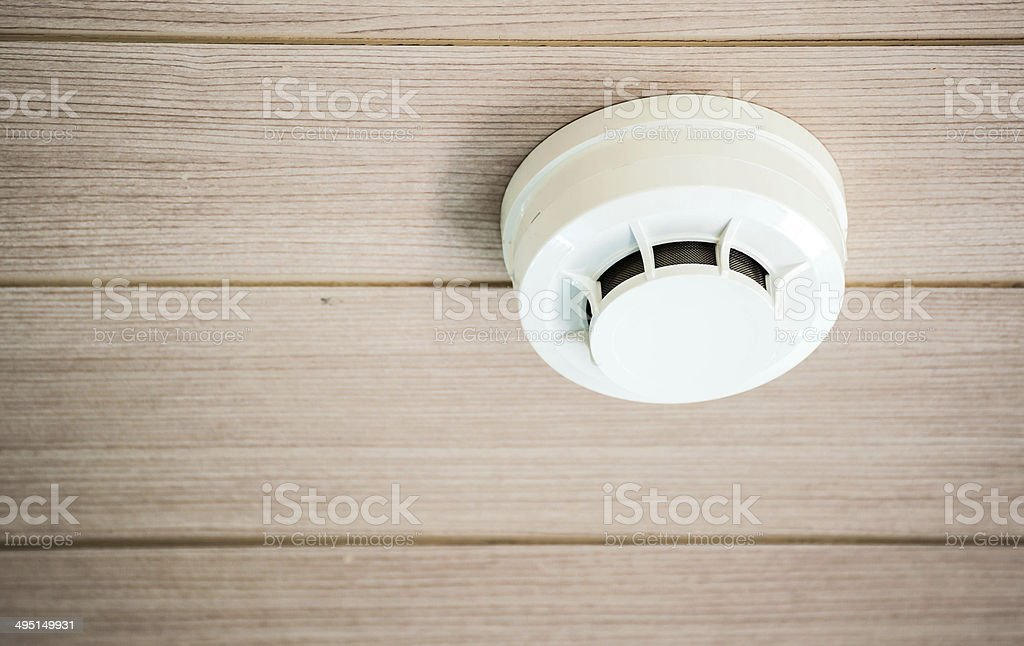 smoke detector system on a ceiling stock photo