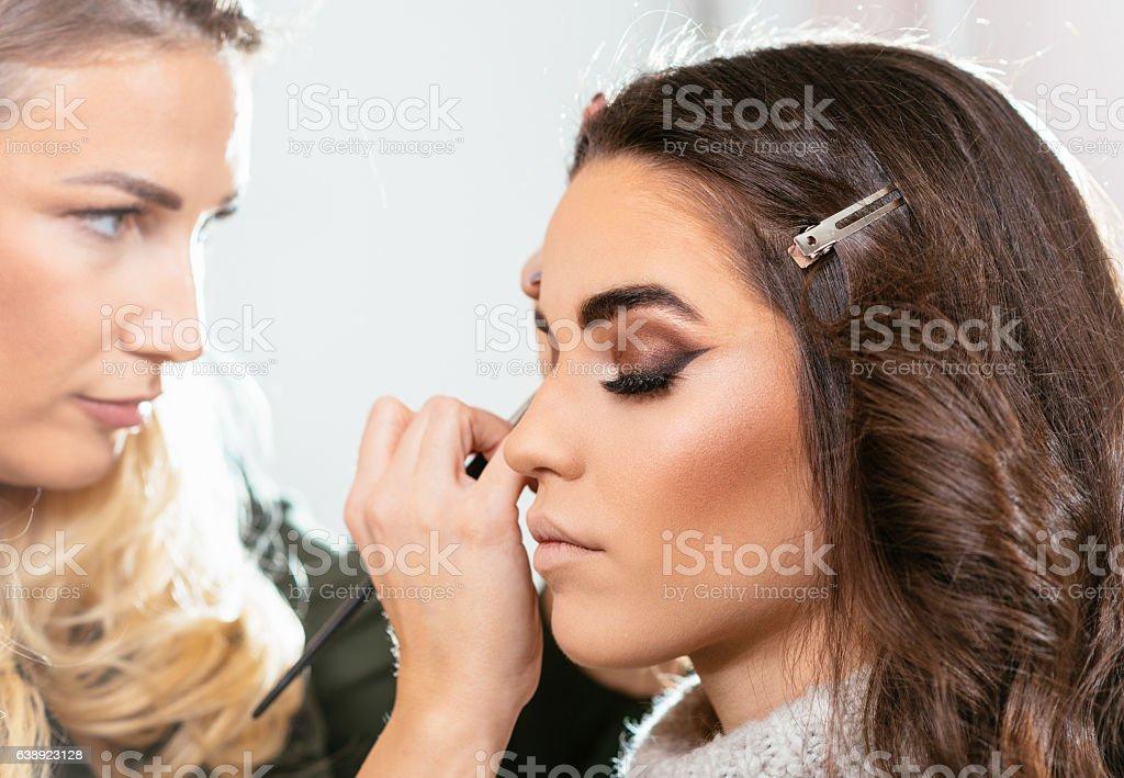 Smoke eye make up on beautiful female model stock photo