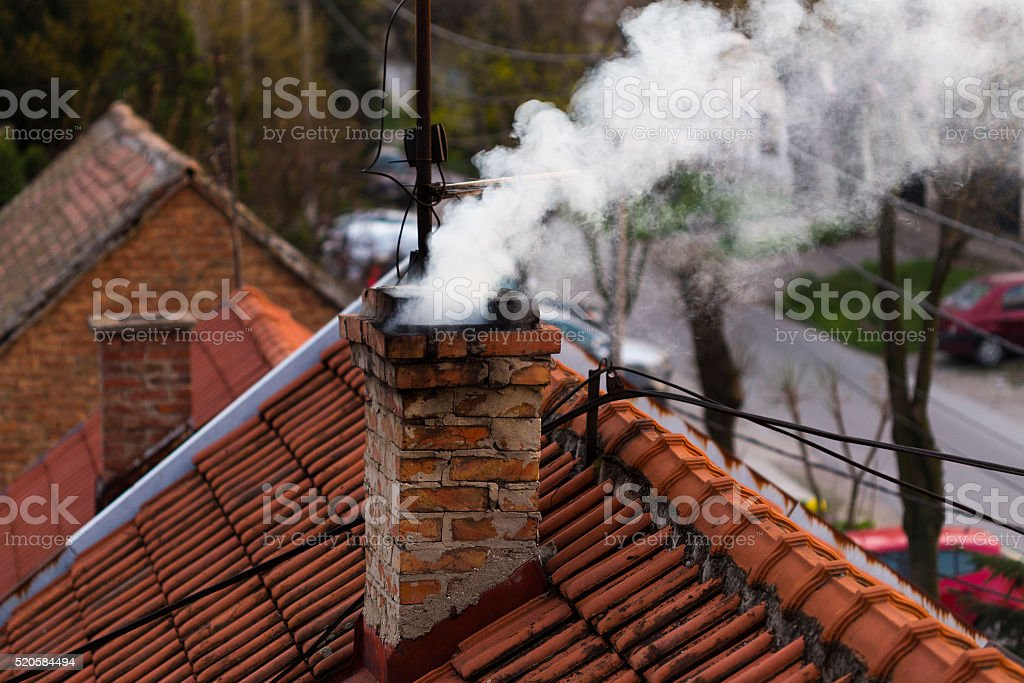 Smoke from a chimney stock photo