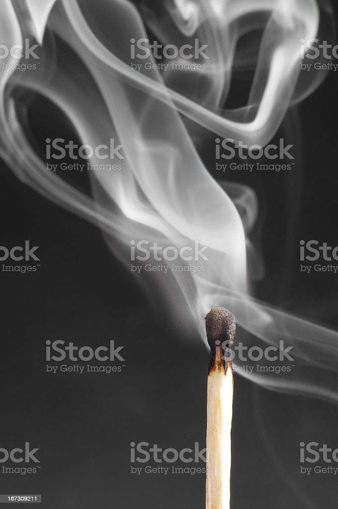 Smoke from a match that was just put out royalty-free stock photo