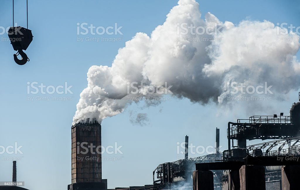 Smoke from a pipe factory polluting air, environmental problems stock photo