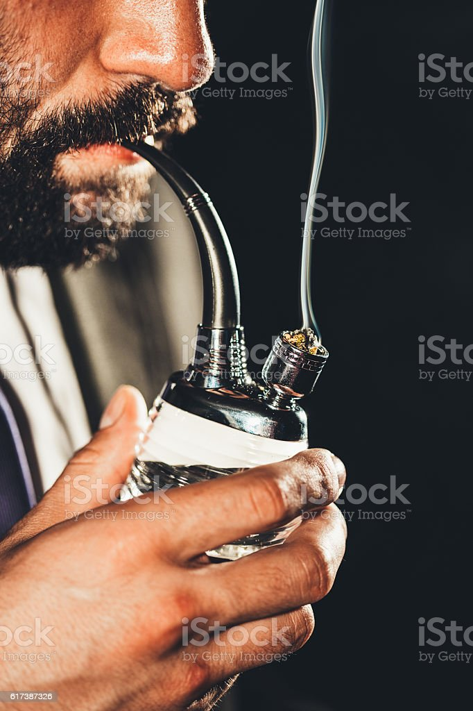 Smoke from a pipe stock photo