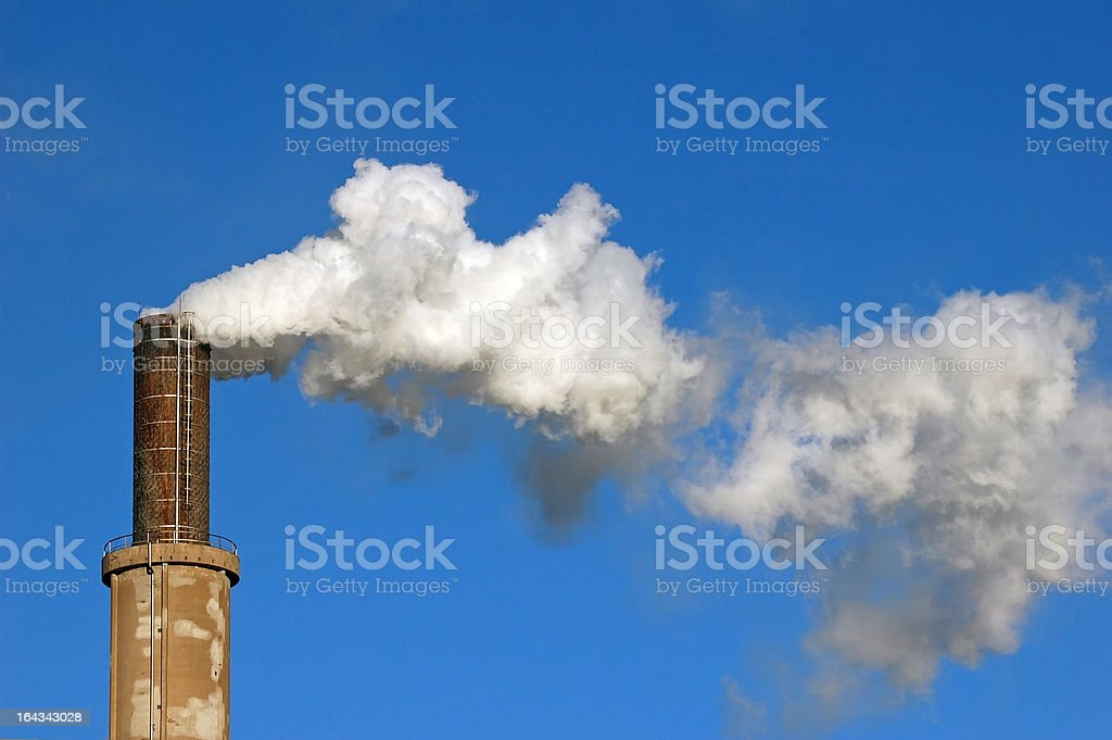 smoke from chimney at winter royalty-free stock photo