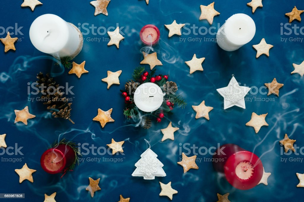 Smoke from extinguished candles, Christmas theme, top view, on blue stock photo