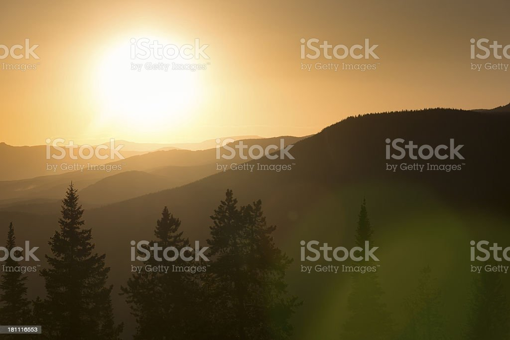 Smoke From Nearby Colorado Forest Fires Diffuses This Vail Sunset stock photo
