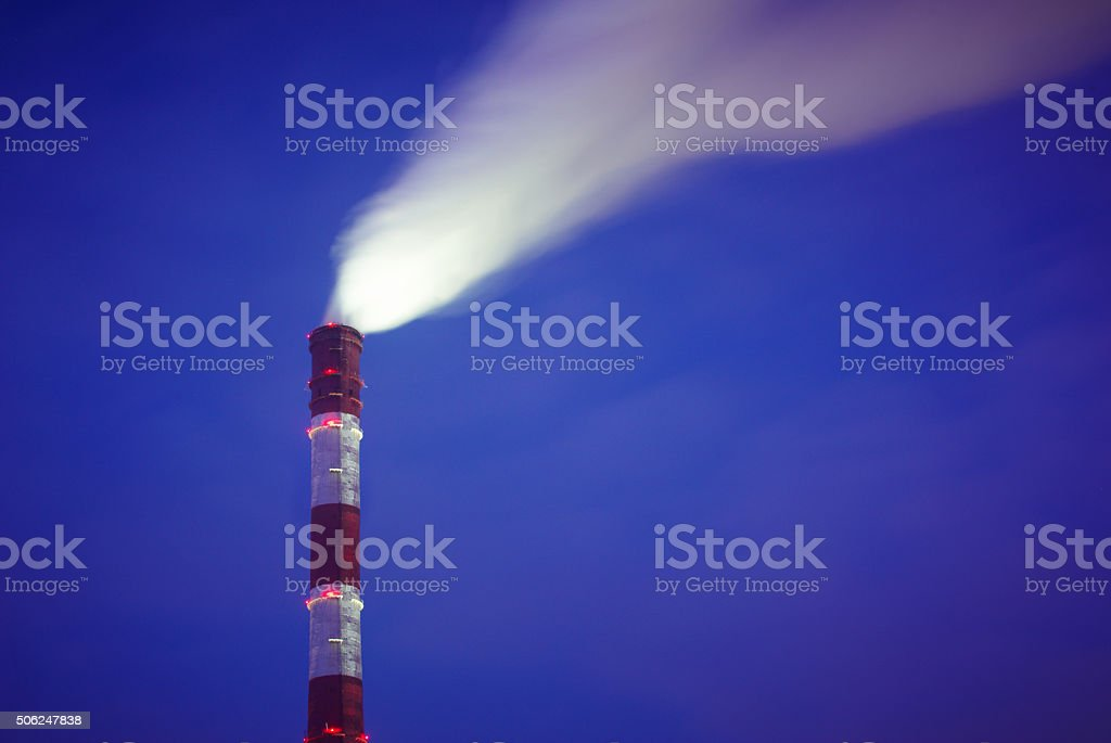 smoke from the chimney stock photo