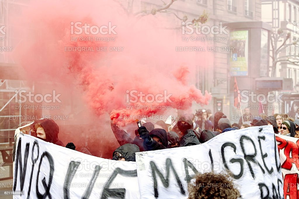 Smoke grenades and paint on walls at protest stock photo