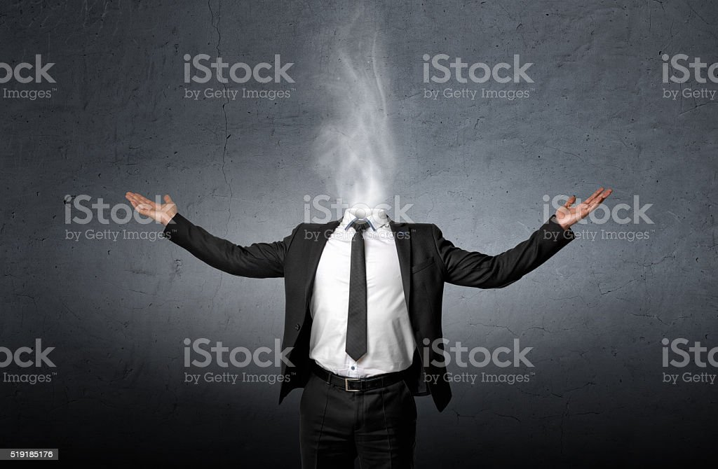 Smoke instead of a businessman head who raised his hands stock photo