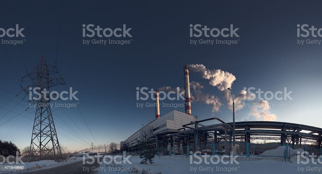 Smoke is formed from boiler at susnset. stock photo