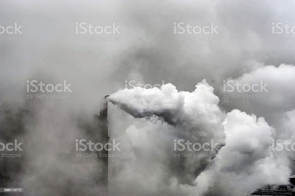 Smoke of heavy industry is highlighted stock photo
